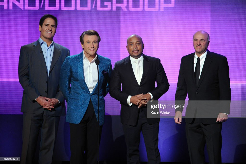 TV personalities <a gi-track='captionPersonalityLinkClicked' href=/galleries/search?phrase=Mark+Cuban&family=editorial&specificpeople=203295 ng-click='$event.stopPropagation()'>Mark Cuban</a>, Robert Herjavec, Daymond John, and Kevin O'Leary speak onstage during the 2013 American Music Awards at Nokia Theatre L.A. Live on November 24, 2013 in Los Angeles, California.