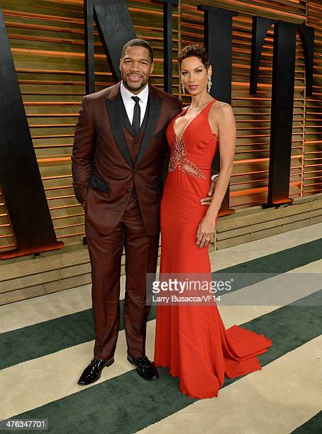 TV personalities Michael Strahan and Nicole Murphy attend the 2014 Vanity Fair Oscar Party Hosted By Graydon Carter on March 2 2014 in West Hollywood...