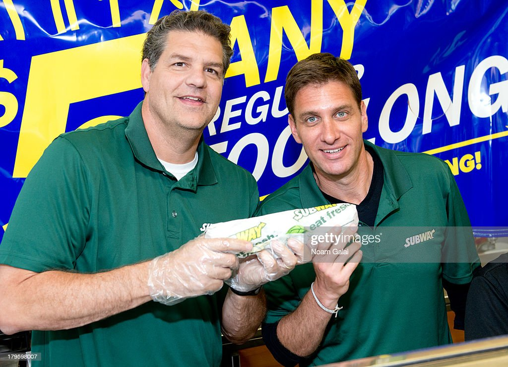 ESPN personalities Mike Golic and Mike Greenberg promote 'SUBtember at Subway' at Subway Restaurant on September 5 2013 in New York City