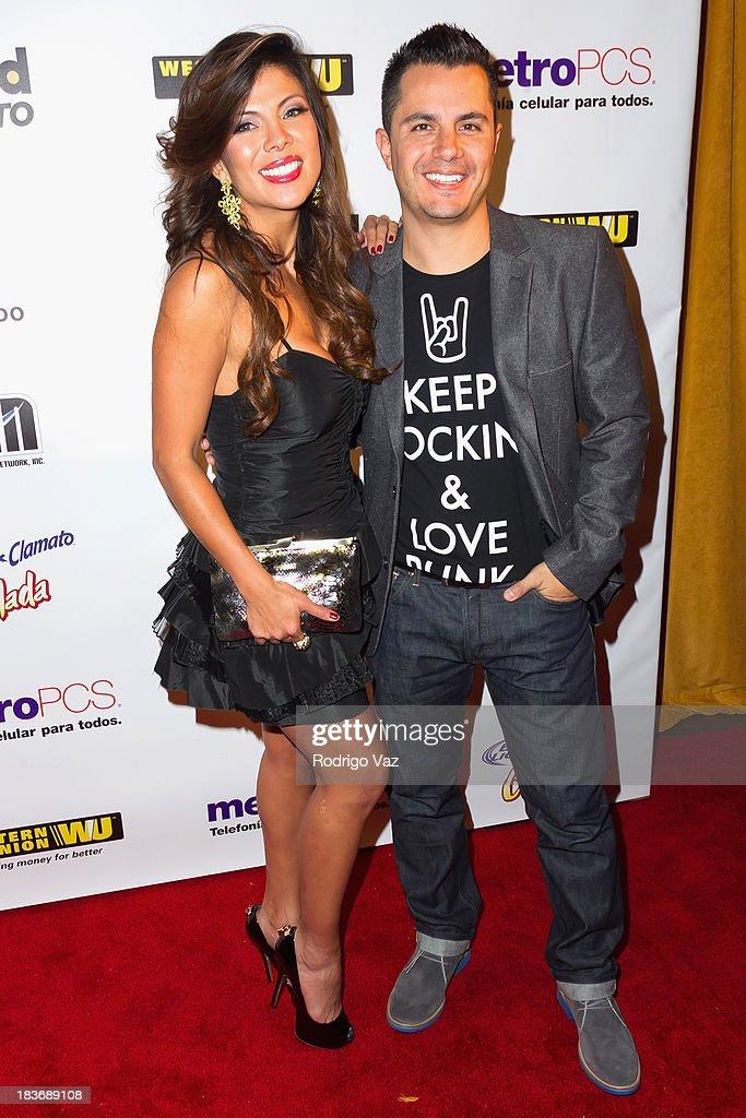 TV personalities Mirella Grisales (L) and Karim Mendiburu attend Billboard In Concert Series presents Calibre 50 at The Conga Room at L.A. Live on October 8, 2013 in Los Angeles, California.