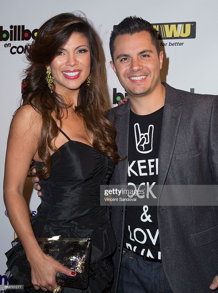 TV personalities Mirella Grisales (L) and Karim Mendiburu attend Billboard In Concert Series presents Calibre 50 at The Conga Room at The Conga Room at L.A. Live on October 8, 2013 in Los Angeles, California.