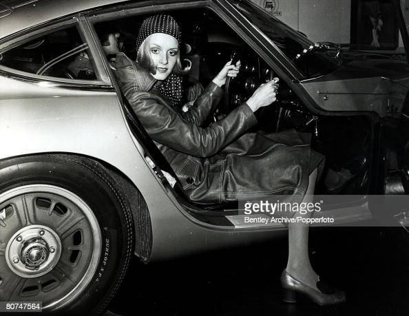8th February 1968 London British model Twiggy wearing 1930's style maxi coat and spotted headscarf takes delivery of her new Toyota 2000 GT sports car