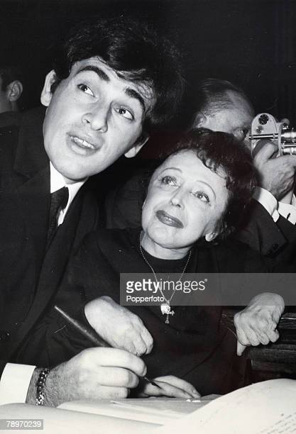 October 1962 Paris France Famous French singer Edith Piaf marries former Greek barber turned actor Theo Lamboukas as they sign the register during a...