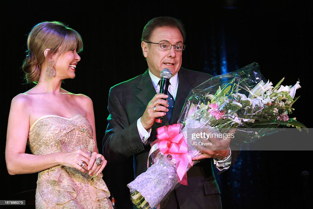 TV Personalities Myrka Dellanos (L) and Enrique Gratas on stage during the launch party for Estrella TV news anchor: Myrka Dellanos at The Conga Room at L.A. Live on May 1, 2013 in Los Angeles, California.