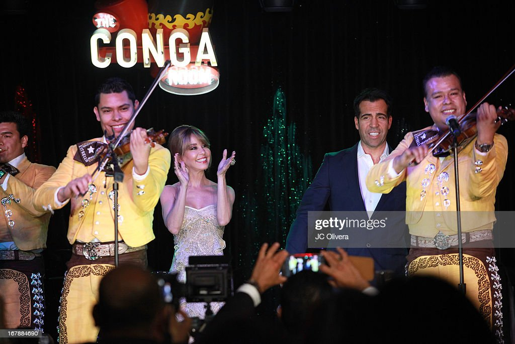 TV Personalities Myrka Dellanos (C) and Felipe Viel on stage during the launch party for Estrella TV news anchor: Myrka Dellanos at The Conga Room at L.A. Live on May 1, 2013 in Los Angeles, California.