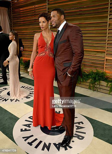 TV personalities Nicole Murphy and Michael Strahan attend the 2014 Vanity Fair Oscar Party Hosted By Graydon Carter on March 2 2014 in West Hollywood...