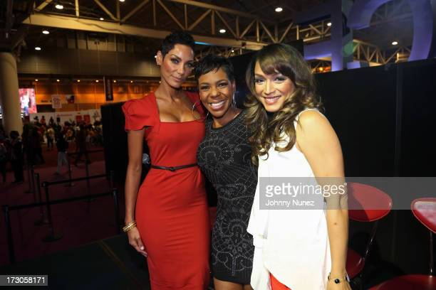 TV personalities Nicole Murphy Andrea Kelly and Mayte Garcia attend the 2013 Essence Festival seminars at the Ernest N Morial Convention Center on...