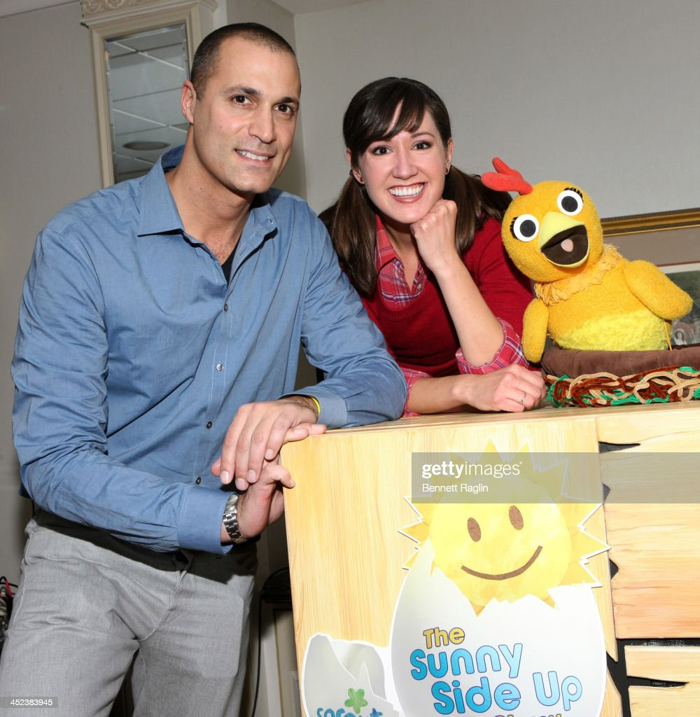 TV personalities Nigel Barker Kelly Vrooman and Chica attend Sprout and friends at the 24hour preschool network's Thanksgiving Day Parade Party at...