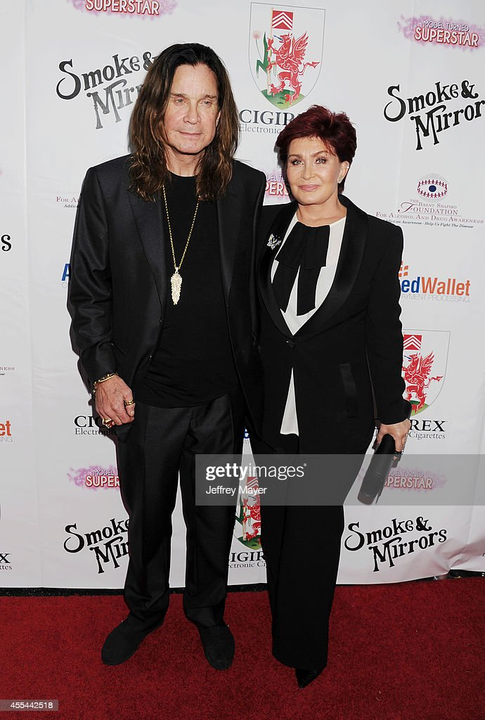 TV personalities Ozzy Osbourne (L) and Sharon Osbourne attend the Brent Shapiro Foundation for Alcohol and Drug Awareness' annual 'Summer Spectacular Under The Stars' at a private residence on September 13, 2014 in Beverly Hills, California.