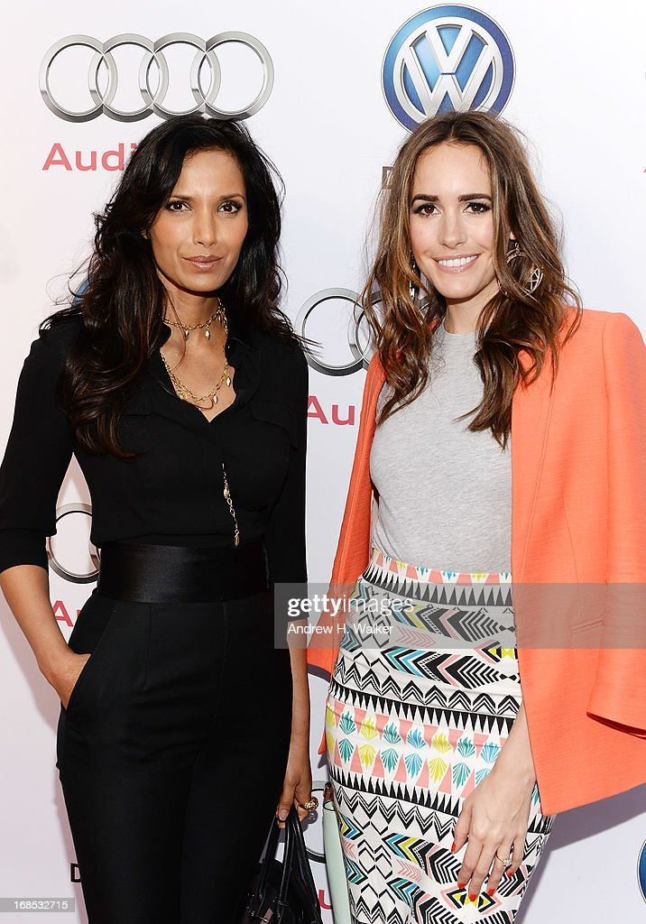 TV personalities Padma Lakshmi (L) and Louise Roe attend the grand opening of the Audi and Volkswagen Manhattan dealership on May 10, 2013 in New York City.