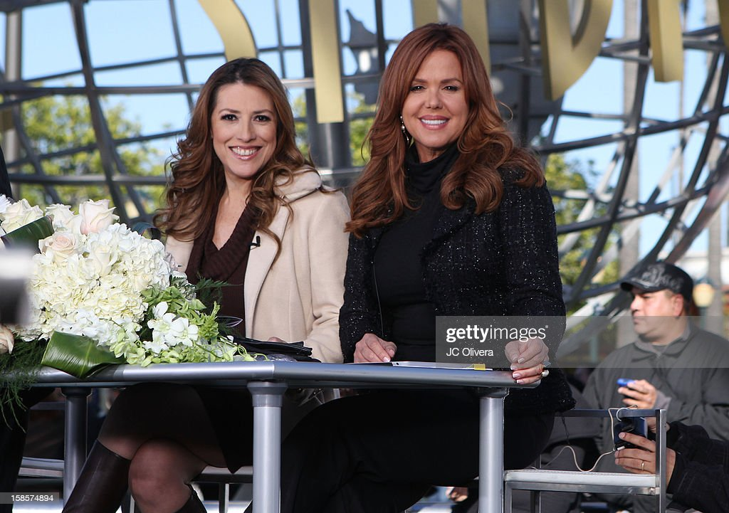 TV Personalities Patricia Candiani (L) and <a gi-track='captionPersonalityLinkClicked' href=/galleries/search?phrase=Maria+Celeste+Arraras&family=editorial&specificpeople=221494 ng-click='$event.stopPropagation()'>Maria Celeste Arraras</a> broadcast a special edition of their national tv show 'Al Rojo Vivo' outside the Gibson Amphitheater during Jenni Rivera Celestial Graduation at Universal City Walk on December 19, 2012 in Universal City, California.