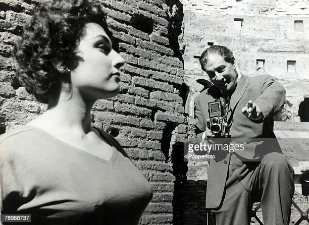 circa 1954 Top photographer Baron at work in Rome with actress Franka Parisi posing
