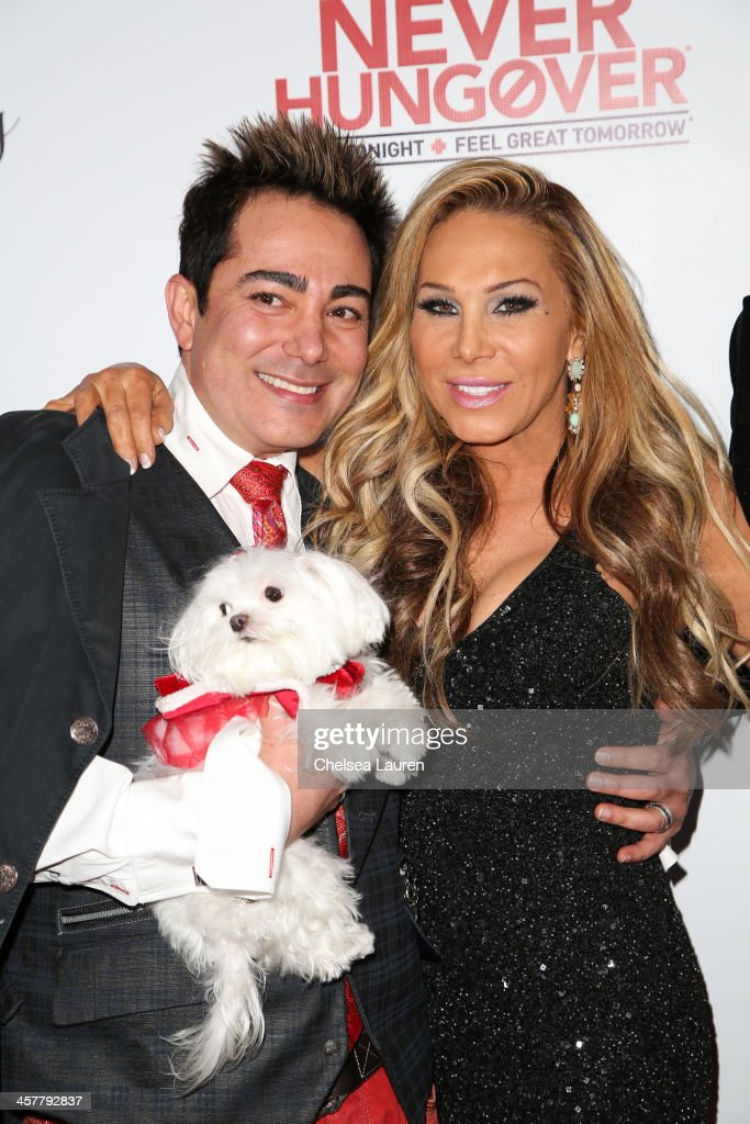 TV personalities Pol' Atteu (L) and Adrienne Maloof arrive at The Maloof Foundation and Jacob's Peter W. Busch family foundation holiday toy donation on December 18, 2013 in Beverly Hills, California.