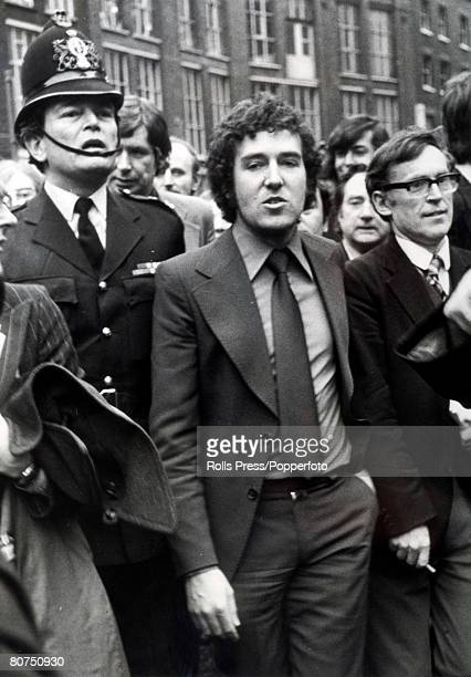 9th April 1976 The Young Liberal leader Peter Hain is escorted by a uniformed policeman from the Old Bailey London after being found not guilty on a...
