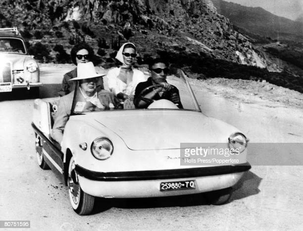 July 1959 Pictured in a small car Sir Winston Churchill with Aristotle Onassis driving after leaving Onassis' yacht 'Christina' as they leave to see...