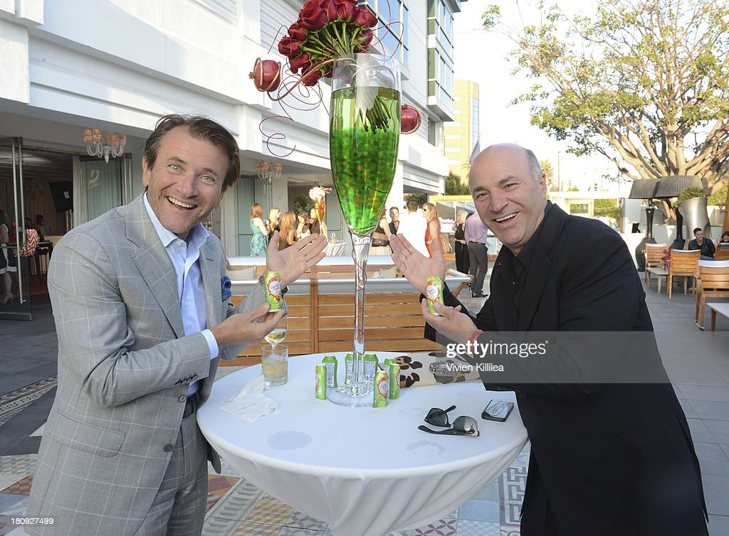 TV personalities Robert Herjavec and Kevin O'Leary attend the Entertainment Tonight And Crystal Light Pre-Emmy Party at SLS Hotel on September 17, 2013 in Beverly Hills, California.