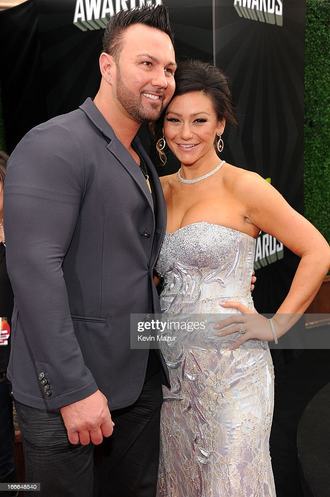 TV personalities Roger Mathews (L) and Jenni 'Jwoww' Farley arrive at the 2013 MTV Movie Awards at Sony Pictures Studios on April 14, 2013 in Culver City, California.