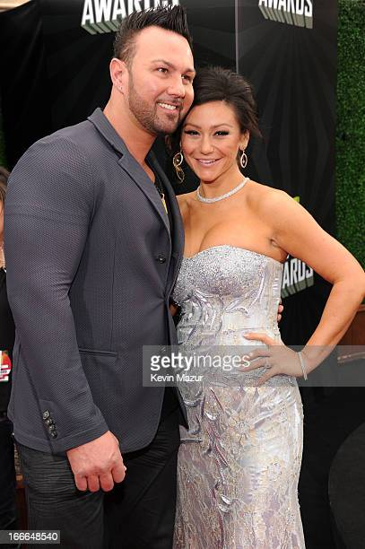 TV personalities Roger Mathews and Jenni 'Jwoww' Farley arrive at the 2013 MTV Movie Awards at Sony Pictures Studios on April 14 2013 in Culver City...