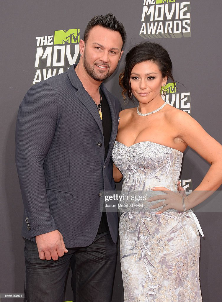 TV personalities Roger Mathews and Jenni 'Jwoww' Farley arrive at the 2013 MTV Movie Awards at Sony Pictures Studios on April 14, 2013 in Culver City, California.