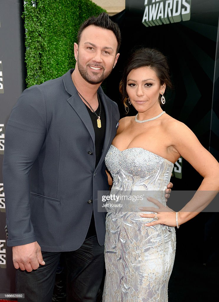 TV personalities Roger Mathews and Jenni 'Jwoww' Farley attend the 2013 MTV Movie Awards at Sony Pictures Studios on April 14, 2013 in Culver City, California.