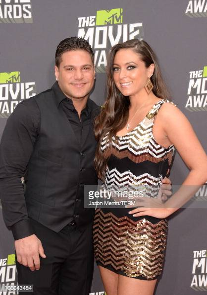 TV personalities Ronnie OrtizMagro and Sammi Giancola arrive at the 2013 MTV Movie Awards at Sony Pictures Studios on April 14 2013 in Culver City...