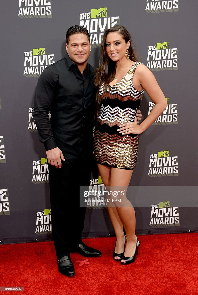 TV personalities Ronnie Ortiz-Magro and Sammi Giancola arrive at the 2013 MTV Movie Awards at Sony Pictures Studios on April 14, 2013 in Culver City, California.