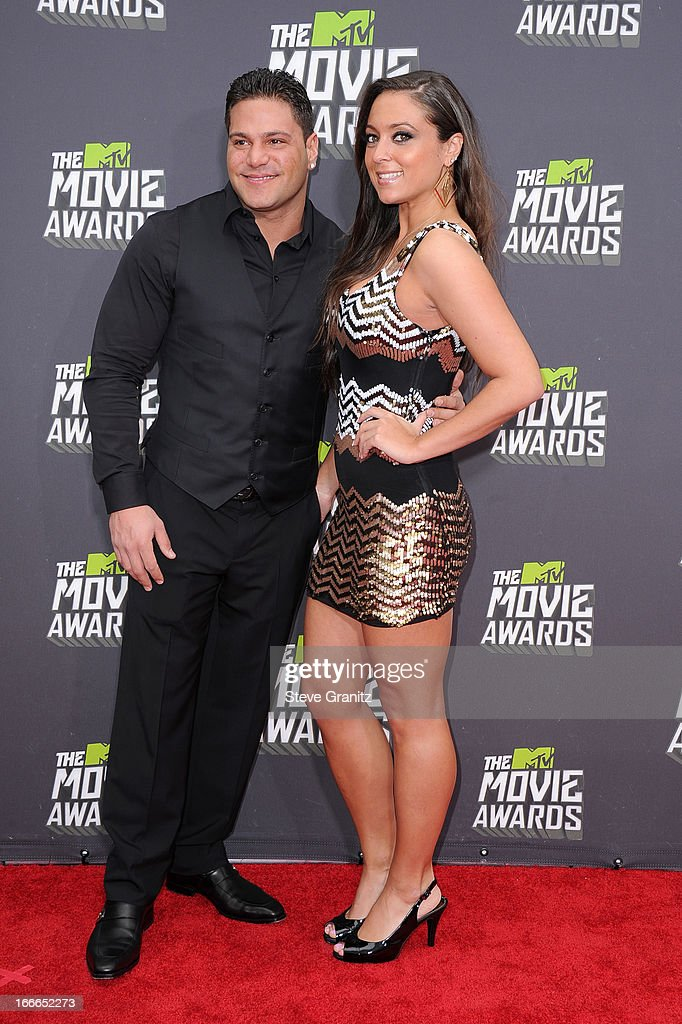 TV personalities Ronnie Ortiz-Magro and Sammi Giancola arrives at the 2013 MTV Movie Awards at Sony Pictures Studios on April 14, 2013 in Culver City, California.