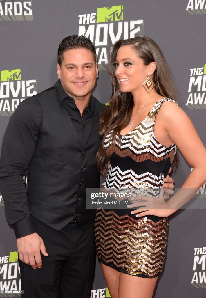TV personalities Ronnie Ortiz-Magro (L) and Sammi 'Sweetheart' Giancola arrives at the 2013 MTV Movie Awards at Sony Pictures Studios on April 14, 2013 in Culver City, California.