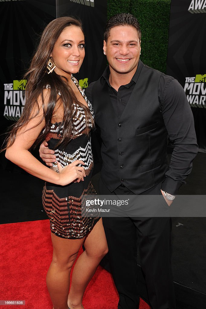TV personalities Sammi Giancola and Ronnie Ortiz-Magro arrive at the 2013 MTV Movie Awards at Sony Pictures Studios on April 14, 2013 in Culver City, California.