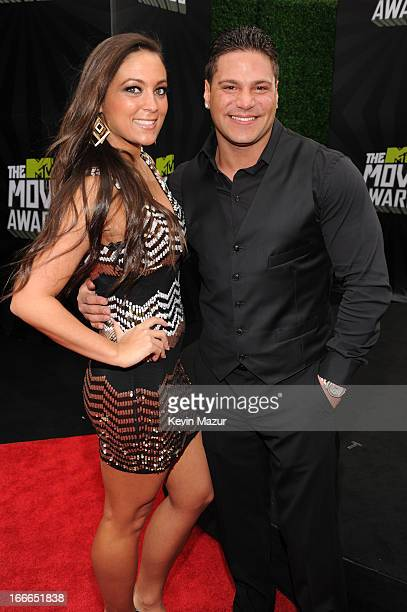 TV personalities Sammi Giancola and Ronnie OrtizMagro arrive at the 2013 MTV Movie Awards at Sony Pictures Studios on April 14 2013 in Culver City...