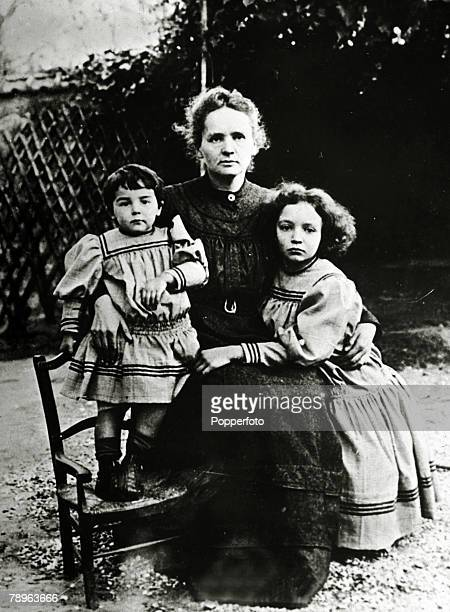 circa 1903 Marie Curie 18671934 pictured with her daughters Eve left and Irene Marie Curie won the 1903 Nobel Prize for Physics with husband Pierre...