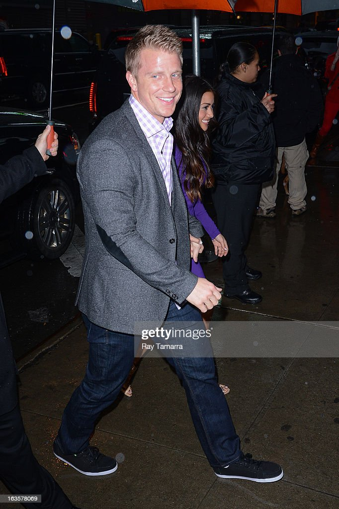 TV personalities Sean Lowe (L) and Catherine Giudici enter the 'Good Morning America' taping at the ABC Times Square Studios on March 12, 2013 in New York City.