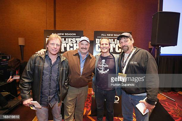 TV personalities Sig Hansen Keith Colburn and Jonathan Hillstrand pose with a fan at Deadliest Catch's Twitter For Tough Guys during the 2013 SXSW...