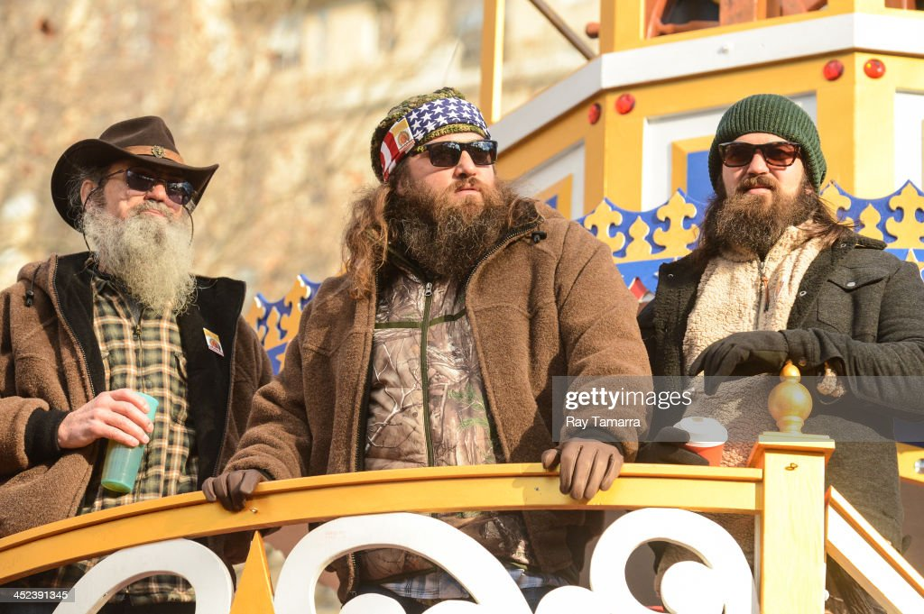 TV personalities Silas Merritt 'Si' Robertson, WIllie Robertson, and Jase Robertson attend the 87th Annual Macy's Thanksgiving Day Parade on November 28, 2013 in New York City.