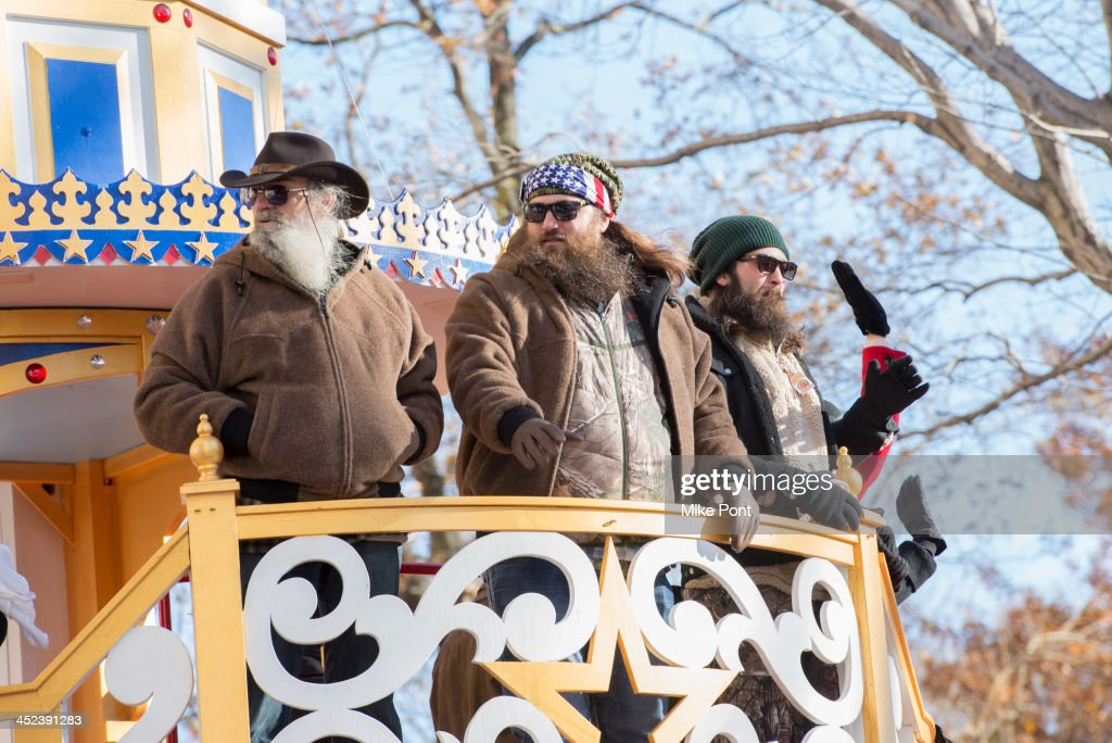 TV personalities Silas Merritt 'Si' Robertson, WIllie Robertson and Jep Robertson of Duck Dynasty attend the 87th annual Macy's Thanksgiving Day parade on November 28, 2013 in New York City.