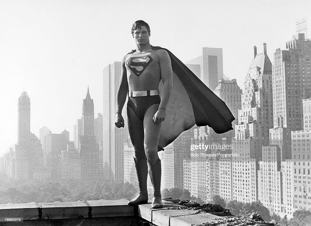 circa 1980, American actor Christopher Reeve (1952-2004) pictured in the 'Superman' role seen against a New York City backdrop