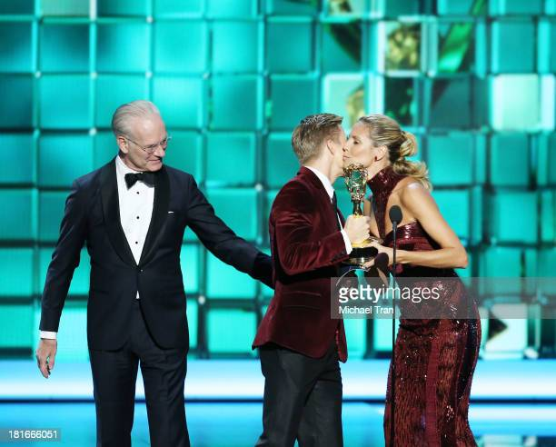 TV personalities Tim Gunn and Heidi Klum present 'Dancing With The Stars'' Derek Hough with the Outstanding Choreography award onstage during the...