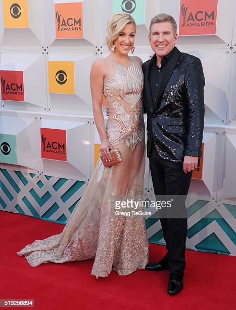 TV personalities Todd Chrisley and Savannah Chrisley arrive at the 51st Academy Of Country Music Awards at MGM Grand Garden Arena on April 3 2016 in...