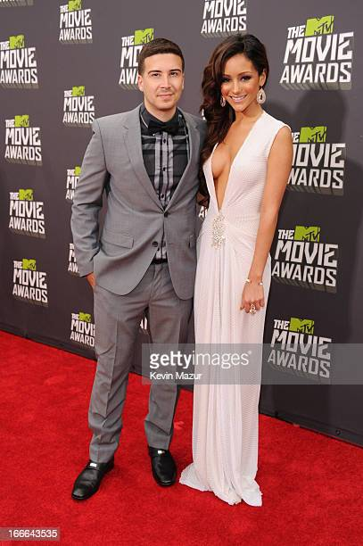 TV personalities Vinny Guadagnino and Melanie Iglesias arrive at the 2013 MTV Movie Awards at Sony Pictures Studios on April 14 2013 in Culver City...