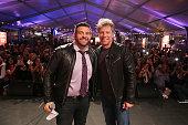 TV personality Adam Richman and musician Jon Bon Jovi appear on stage at Ronzoni's La Sagra Slices hosted by Bongiovi Brand pasta sauces Adam Richman...