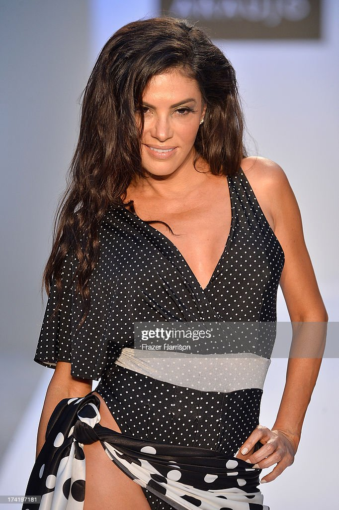TV personality Adriana De Moura walks the runway at the A.Z. Araujo show during Mercedes-Benz Fashion Week Swim 2014 at Oasis at the Raleigh on July 21, 2013 in Miami, Florida.