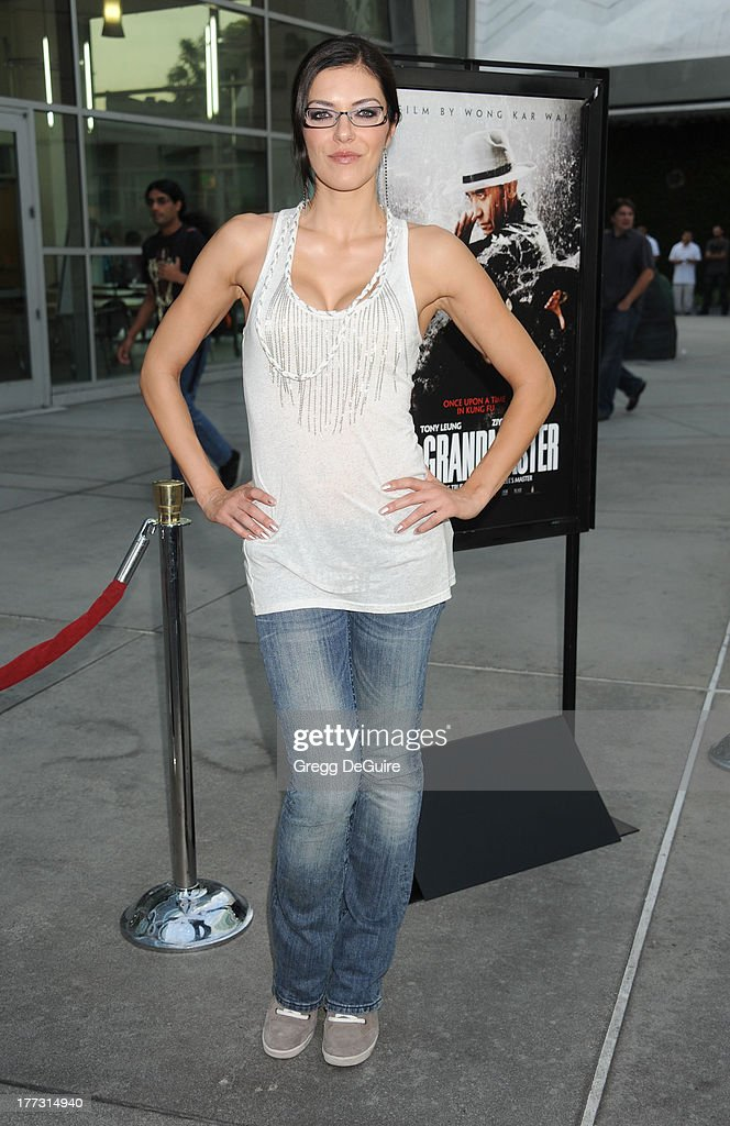 TV personality <a gi-track='captionPersonalityLinkClicked' href=/galleries/search?phrase=Adrianne+Curry&family=editorial&specificpeople=715970 ng-click='$event.stopPropagation()'>Adrianne Curry</a> arrives at the Los Angeles premiere of 'The Grandmaster' at ArcLight Cinemas on August 22, 2013 in Hollywood, California.