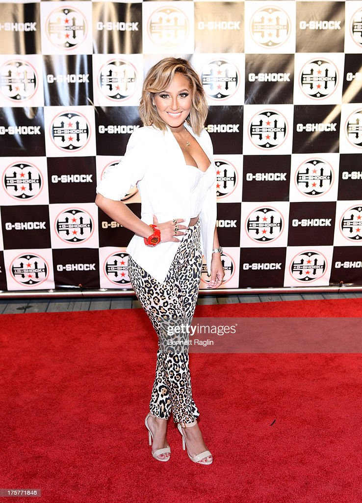 TV personality Adrienne Bailon attends G-Shock - Shock The World 2013 at Basketball City - Pier 36 - South Street on August 7, 2013 in New York City.