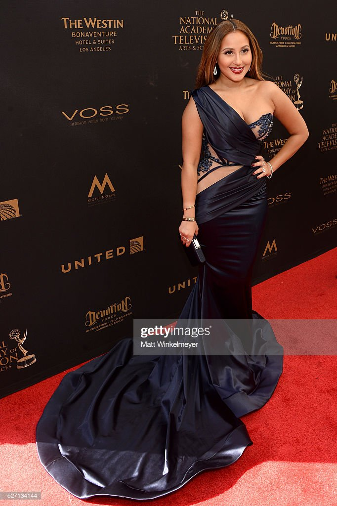 TV personality <a gi-track='captionPersonalityLinkClicked' href=/galleries/search?phrase=Adrienne+Bailon&family=editorial&specificpeople=540286 ng-click='$event.stopPropagation()'>Adrienne Bailon</a> walks the red carpet at the 43rd Annual Daytime Emmy Awards at the Westin Bonaventure Hotel on May 1, 2016 in Los Angeles, California.