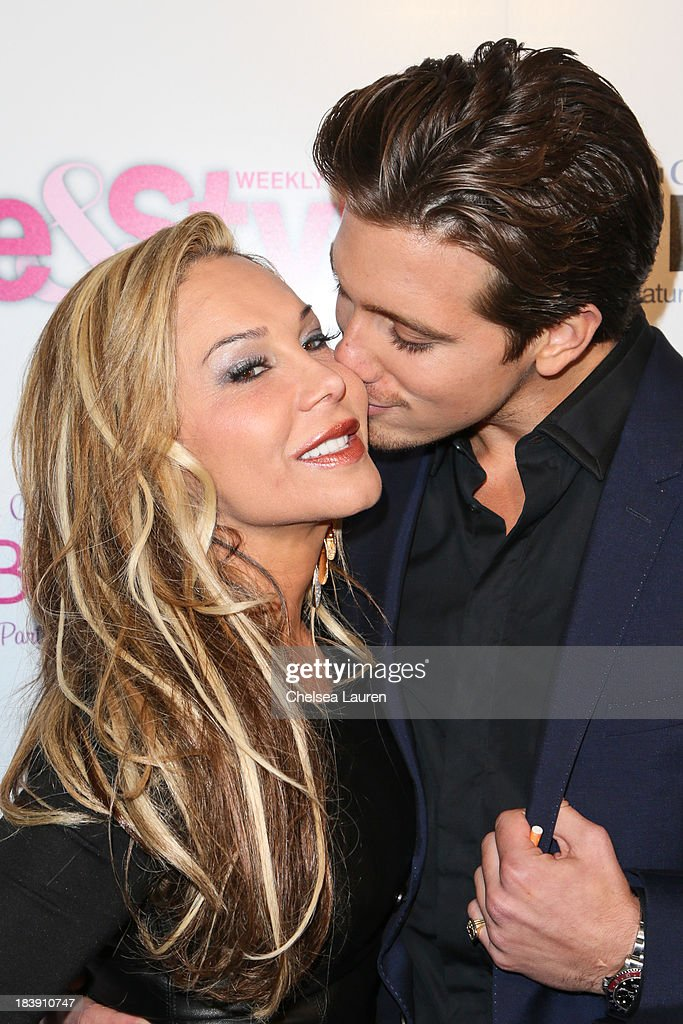 TV personality Adrienne Maloof (L) and Jacob Busch arrive at Life & Style's Hollywood in Bright Pink event hosted by Giuliana Rancic at Bagatelle on October 9, 2013 in Los Angeles, California.