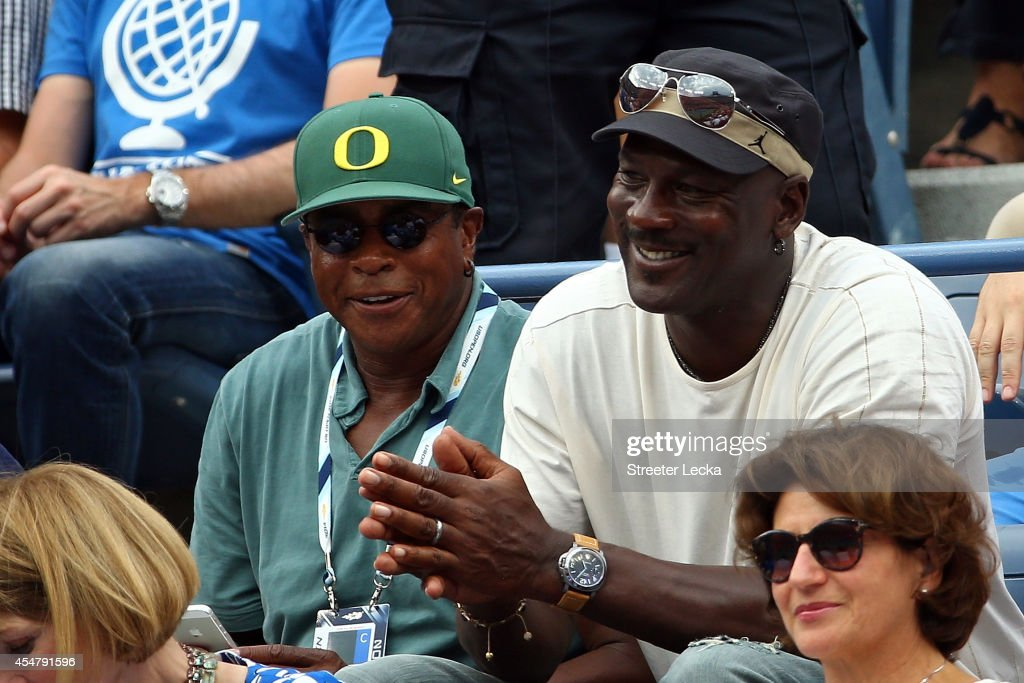 TV personality <a gi-track='captionPersonalityLinkClicked' href=/galleries/search?phrase=Ahmad+Rashad&family=editorial&specificpeople=228301 ng-click='$event.stopPropagation()'>Ahmad Rashad</a> (L) and Basketball Hall of Famer <a gi-track='captionPersonalityLinkClicked' href=/galleries/search?phrase=Michael+Jordan+-+Basketball+Player&family=editorial&specificpeople=73625 ng-click='$event.stopPropagation()'>Michael Jordan</a> attend the men's singles semifinal match between Roger Federer of Switzerland and Marin Cilic of Croatia on Day Thirteen of the 2014 US Open at the USTA Billie Jean King National Tennis Center on September 6, 2014 in the Flushing neighborhood of the Queens borough of New York City.