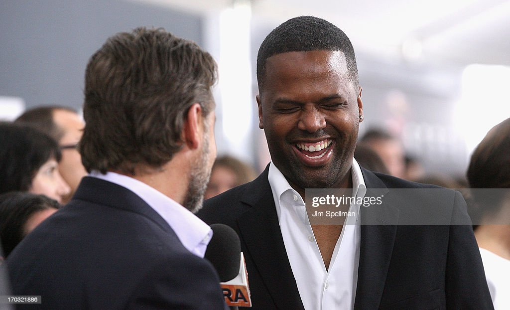 TV personality AJ Calloway (R) speaks to Russell Crowe at the 'Man Of Steel' World Premiere at Alice Tully Hall at Lincoln Center on June 10, 2013 in New York City.