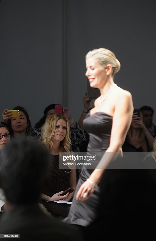 TV Personality Alex McCord (L) watches TV Personality Aviva Drescher walk in the Malan Breton fall 2013 fashion show during Mercedes-Benz Fashion Week at Pier 59 on February 10, 2013 in New York City.
