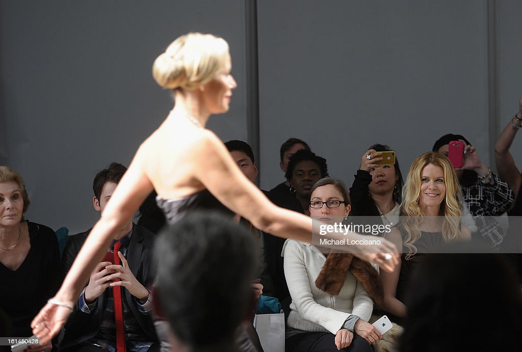TV Personality Alex McCord (R) watches TV Personality Aviva Drescherwalk in the Malan Breton fall 2013 fashion show during Mercedes-Benz Fashion Week at Pier 59 on February 10, 2013 in New York City.