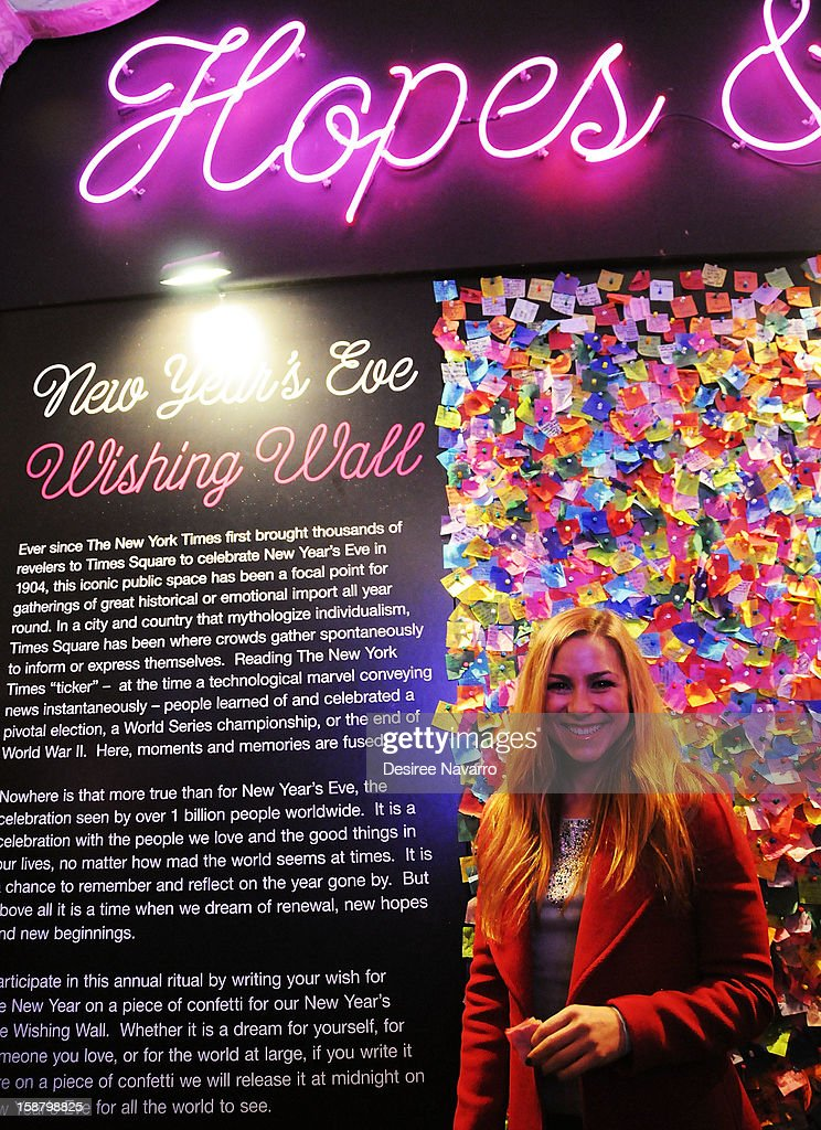 TV Personality Allison Hagendorf poses in front of the Wishing Wall at the New Year's Eve 2013 Confetti Airworthiness Test at Times Square Alliance Building on December 29, 2012 in New York City.